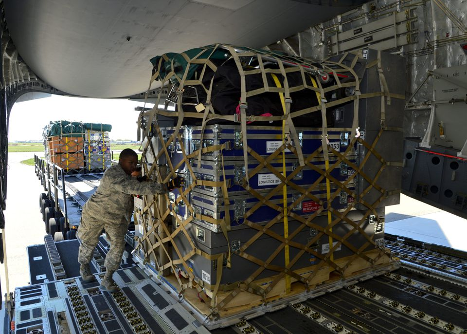 Senior Airman Tavin Alford loaded a pallet with equipment and supplies for the Fairfax County Urban Search and Rescue Team at Dover Air Force Base, Del. The 69-member team is deploying to Nepal.