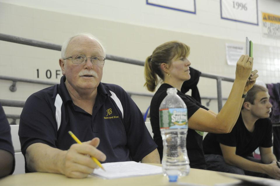 Coach Johnson called out swimmers' names for an Acton-Boxborough meet.
