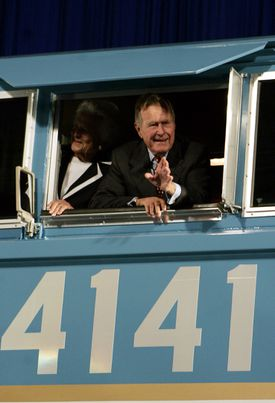 Former President George H.W. Bush and his wife Barbara waved out the window of a new locomotive numbered 4141 in honor of the 41st president at Texas A&M University.