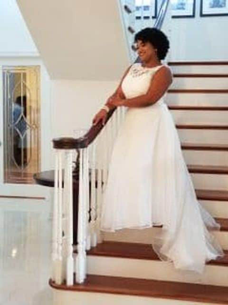 Dulce Gonzalez posed in her wedding dress on the Strunks' staircase.