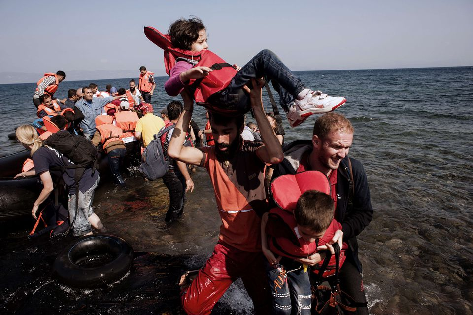 Refugees arrived on the Greek island of Lesbos after crossing the Aegean sea from Turkey on Sept. 21.
