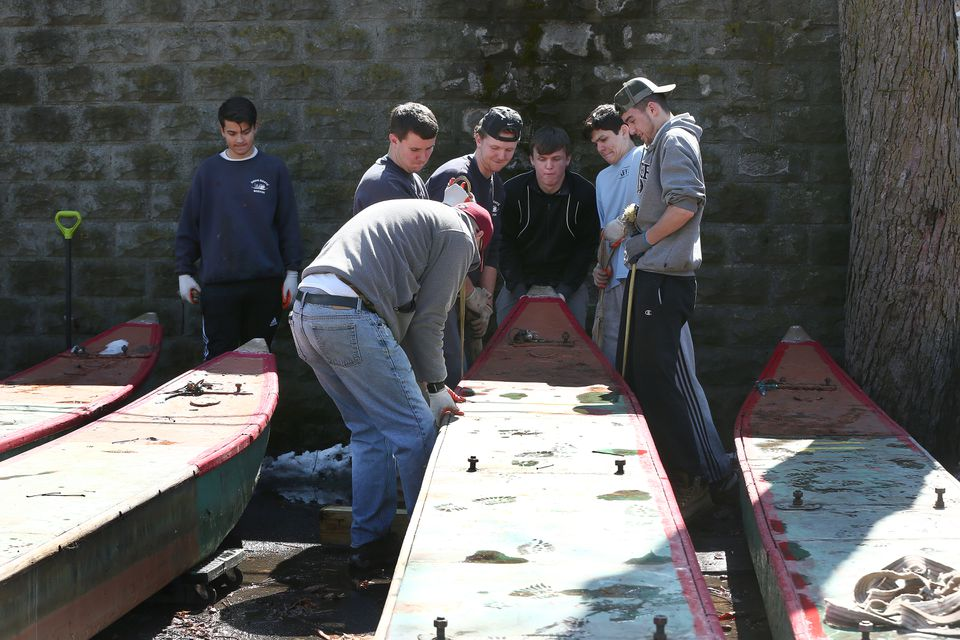 A work crew moved a pontoon so the sides could be accessed.