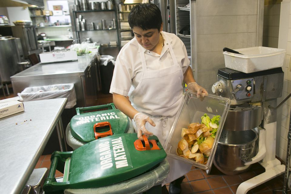 In the kitchen at the Lenox Hotel in Back Bay, Eliza Martinez separates compost.