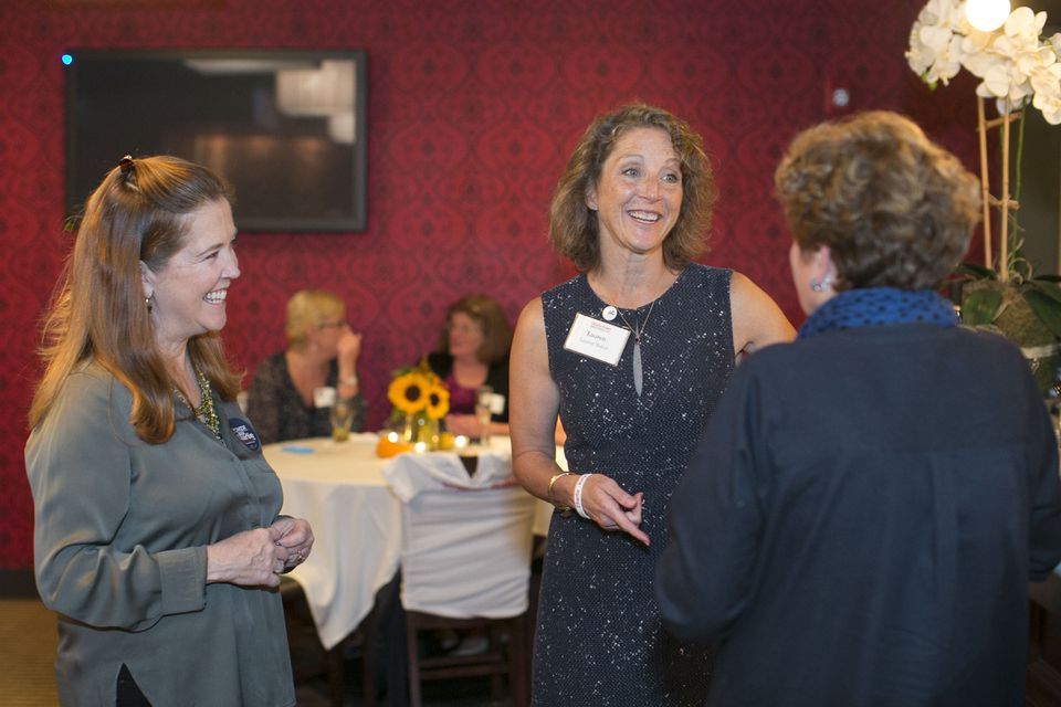 At the Women for Charlie meet-and-greet event, Baker chatted with Eleanor Greene (left) and Karen Hickman.