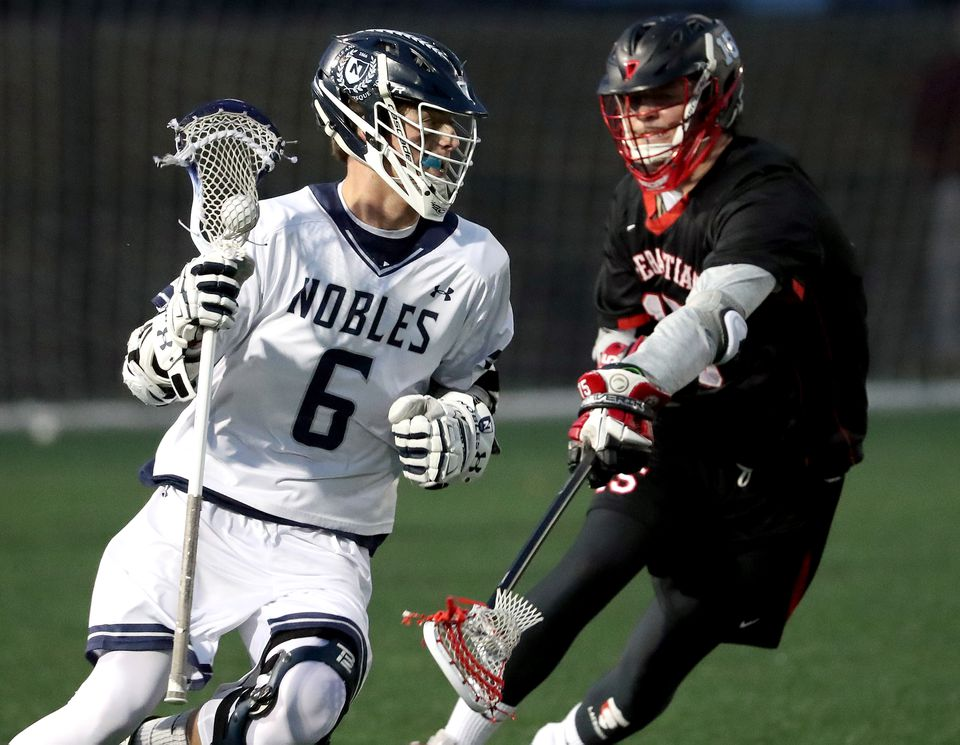 Nobles's Hayden Cheek (left) controls the ball with pressure from St. Sebastian's Will Coyne during first half action of a benefit game for the McCrae James Williams Foundation.