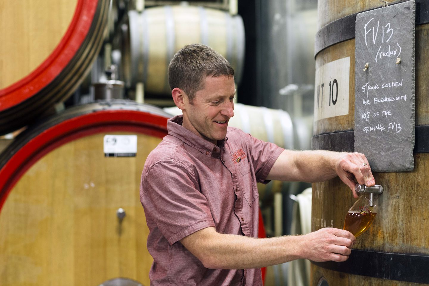 Brewmaster Jason Perkins hard at work with barrel-aged Belgian-style golden ale at Allagash Brewing Company.