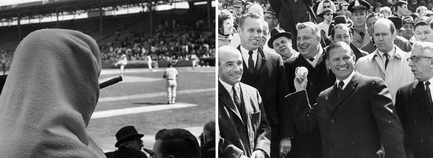 A fan tried to cover up to stay warm while smoking a cigar in the stands of Fenway Park on Opening Day, for which  Massachusetts Governor John Volpe tossed out the first pitch.