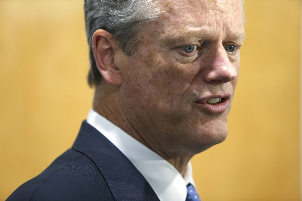 Governor Charlie Baker speaks to reporters in Pepperell on Oct. 11.