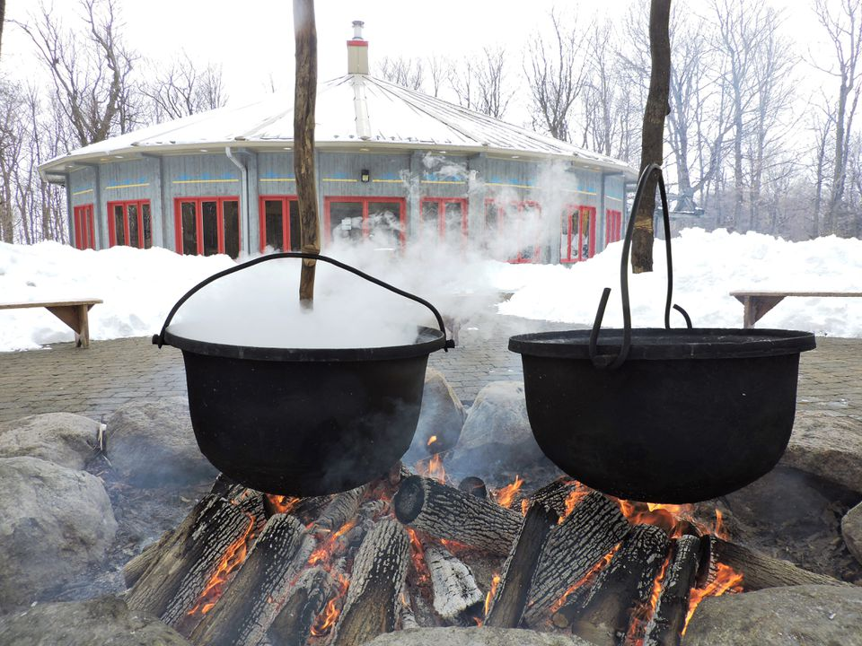 Maple sap boils down in kettles at La Maison Amérindienne.