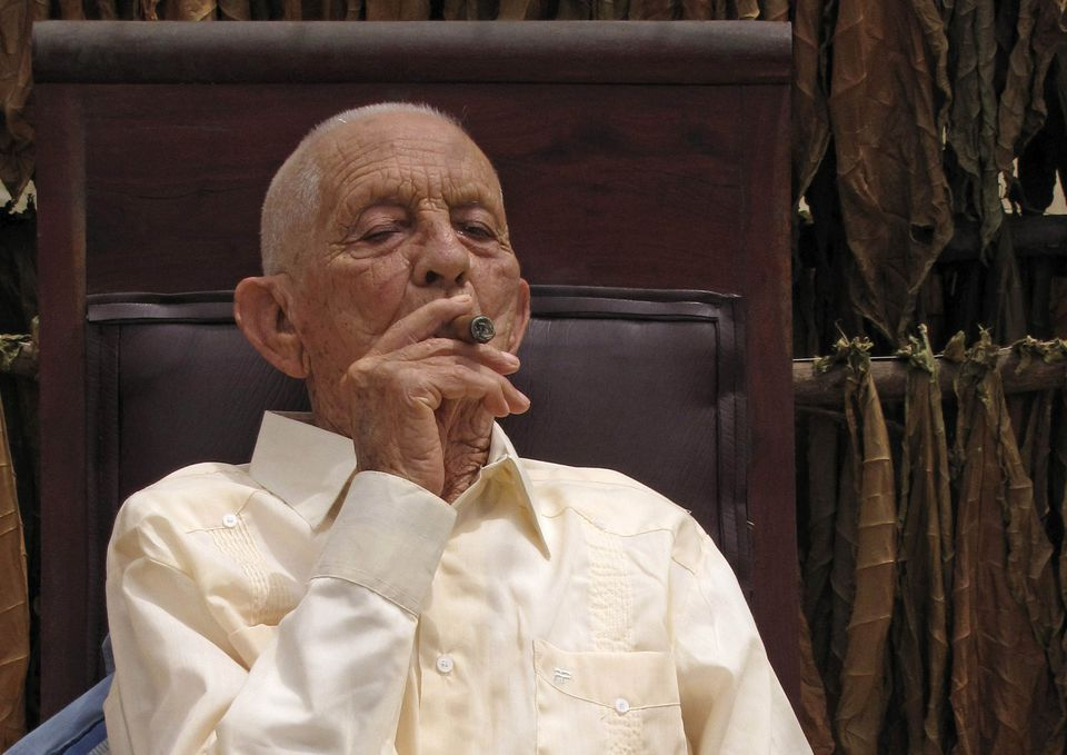 Cuban tobacco legend Alejandro Robaina smokes one of his own brand cigars on his 91st birthday at his farm in Pinar del Rio in this 2010 fphoto. Robaina, known in international cigar circles for producing the best of his country's famous tobacco leaves, died on April 17, 2010 at the age of 91.