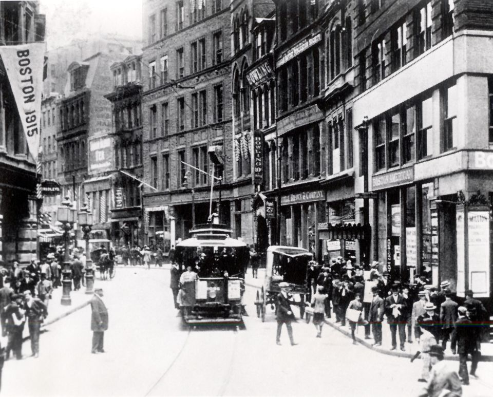 This postcard shows Newspaper Row along Washington Street in 1915, looking much as it did in 1916, when Boston had 10 daily newspapers, most of them clustered between what are now Downtown Crossing and Government Center. Car 393, which never reached its destination that night, was due to turn around near Washington and Summer streets, two blocks south of here.
