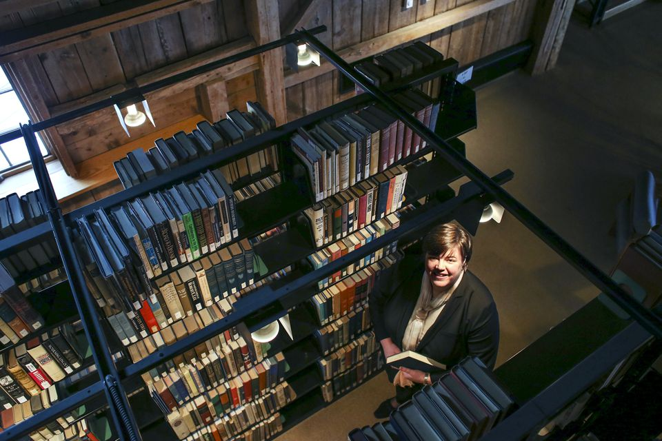 College President Susan Stuebner stood between shelves of books in the campus library on Jan. 10.