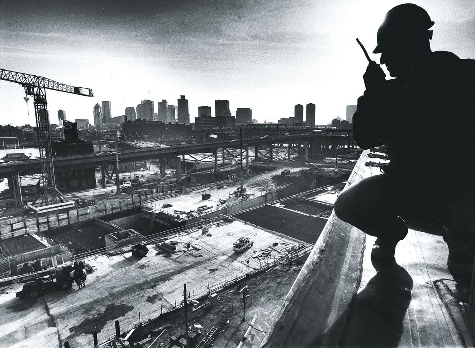 Dan Gasbarre, a Perini Corp. engineer, surveys the construction of tunnels north of downtown from a roof in City Square in 1991.