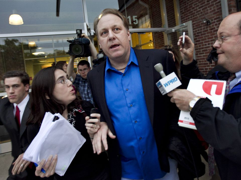 Former Boston Red Sox pitcher Curt Schilling was followed by members of the media as he departed the Rhode Island Economic Development Corporation headquarters in Providence, R.I. His video game company 38 Studios is still under investigation.