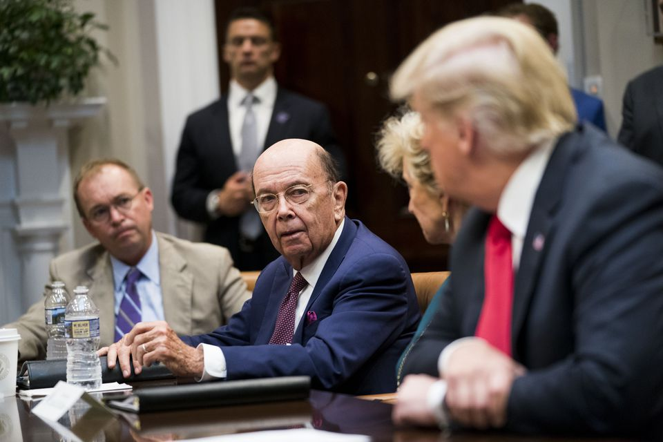 A federal judge said Commerce Secretary Wilbur Ross (center) broke a ''veritable smorgasbord'' of federal rules by overriding the advice of career officials.