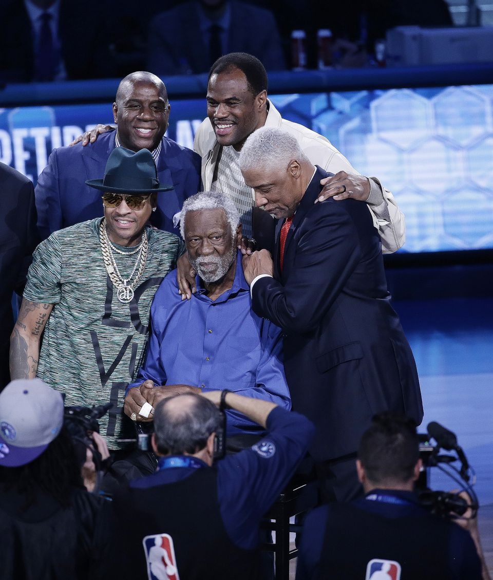 NBA greats (from left) Allen Iverson, Magic Johnson, David Robinson, and Julius Erving, surround Bill Russell during festivities.