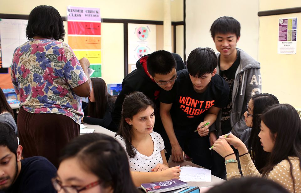 Students gathered to work on a problem in an 11th-grade advanced pre-calculus class.