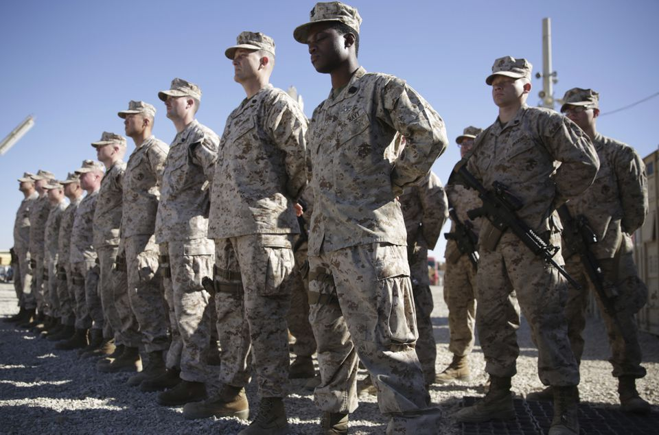 US Marines stood guard during the change of command ceremony at Task Force Southwest military field in Shorab military camp of Helmand province, Afghanistan.