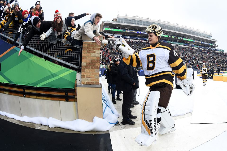 Tuukka Rask celebrates with fans after the win.