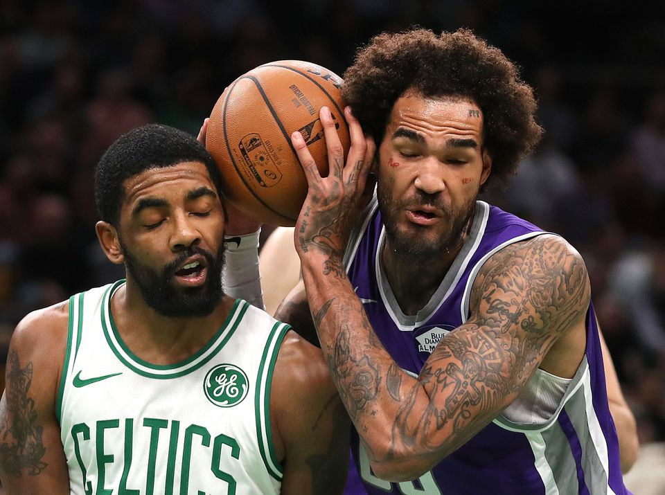 Willie Cauley-Stein goes head to head — with a ball in between — with Kyrie Irving in a battle for a rebound.