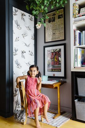 A graphic print of the Flying Horses Carousel on Martha's Vineyard hangs above Clara's desk.
