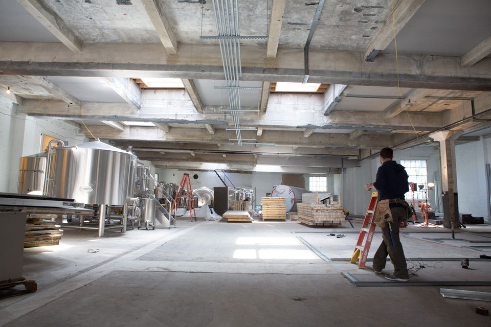 The Lamplighter team is transforming a former auto shop into a craft brewery.
