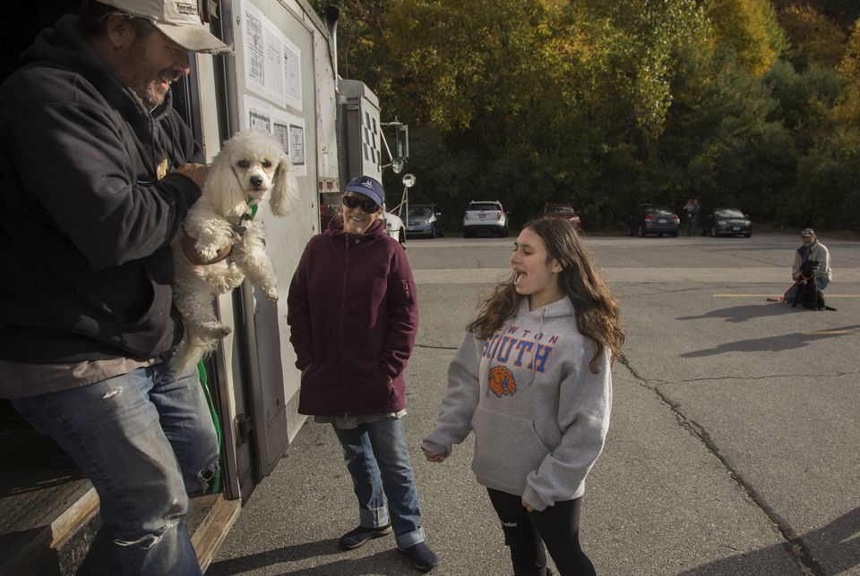 Gavi Azoff, 14, meets her new dog, Jessie, delivered by Greg Mahle.