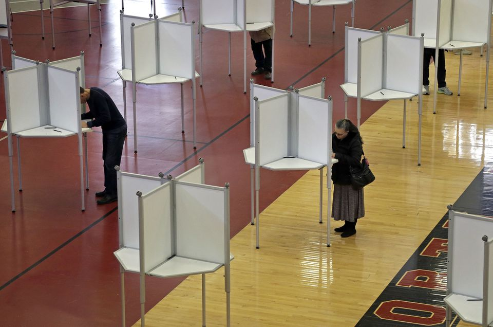 Voters cast their ballots in March duringMassachusetts' primary.
