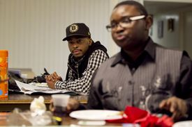 Quincey Roberts (rear), a case manager for the Youth Lounge, watched as a group that included Eziah Karter-Sabir Blake played Monopoly in the basement of Union United Methodist Church in the South End. The Youth Space, a drop-in program that welcomes participants of all sexual orientations, is housed in the basement of the historically black church.