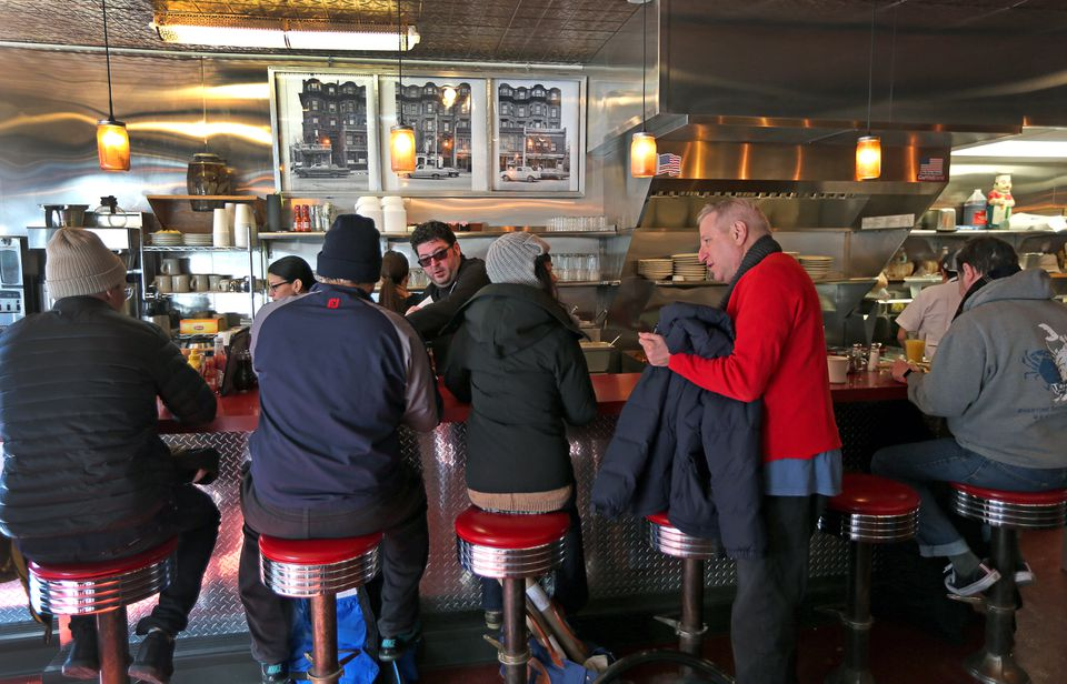 Restaurant owner Evan Deluty greeted customers behind the counter.