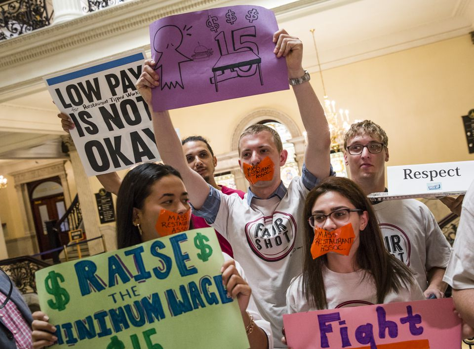 Hospitality industry workers rallied at the State House on Tuesday to seek a higher minimum wage.
