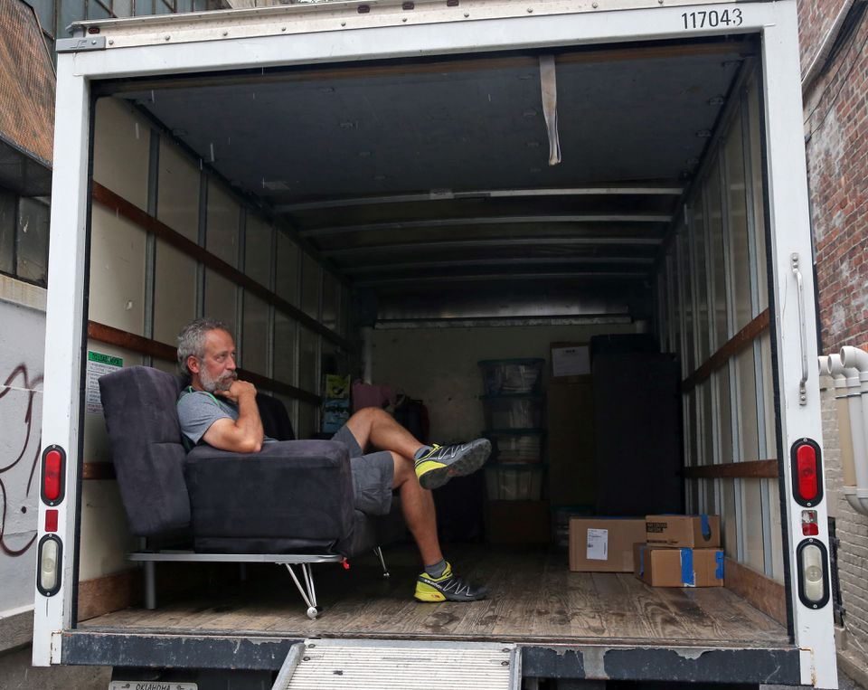 Armin Gunther, from Colorado, waited for his son on a coach in a moving van.