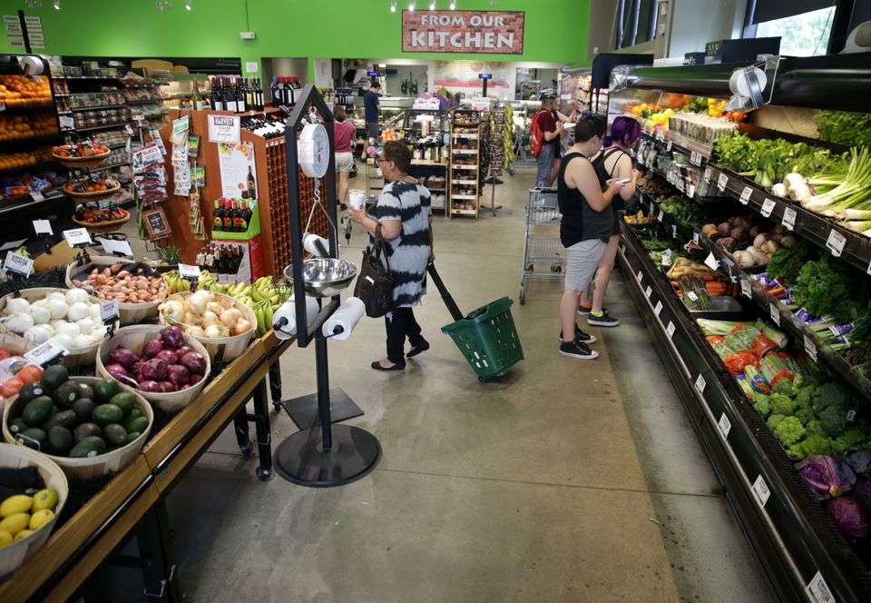 Shoppers at the Harvest Co-op Market in Jamaica Plain. Today, the volunteer worker program is long gone, replaced by 45 full-time and 25 part-time employees in the two Harvest stores.
