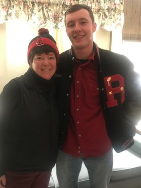Reading's Matt Sannella (right) with his aunt, Stoneham principal Donna Cargill, in Reading colors after Reading beat Stoneham on Thanksgiving Day.