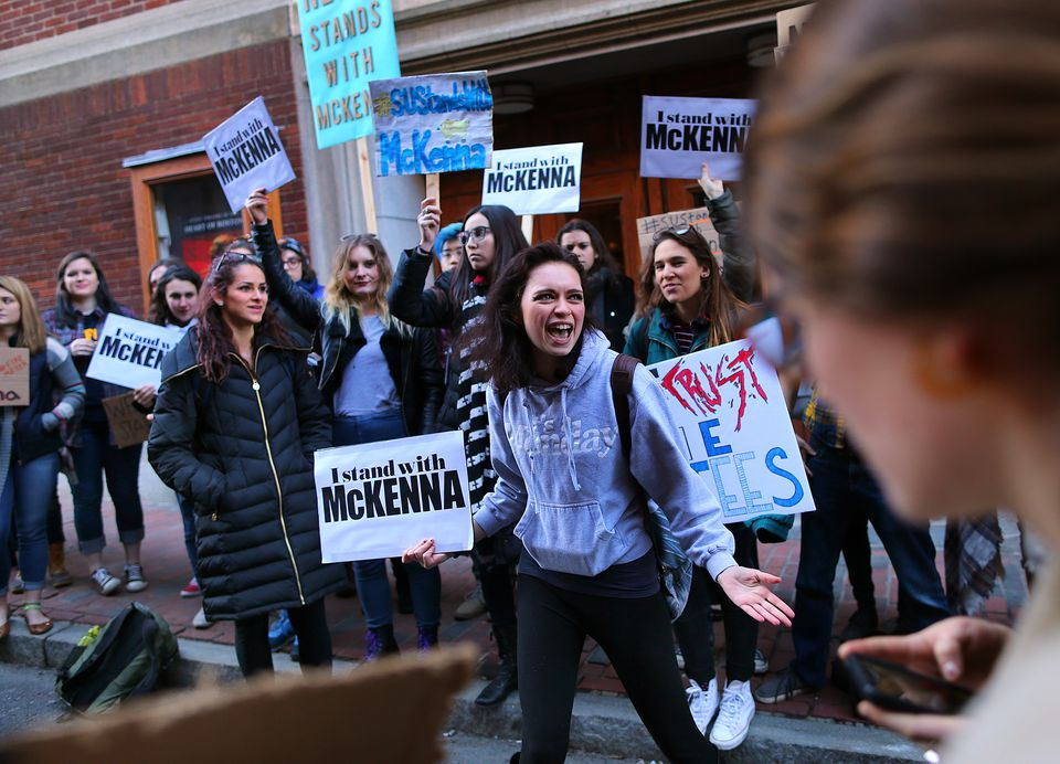 Suffolk University sophomore Yasmine Fersan rallied students outside the C. Walsh Theater in support of their president, Margaret McKenna.