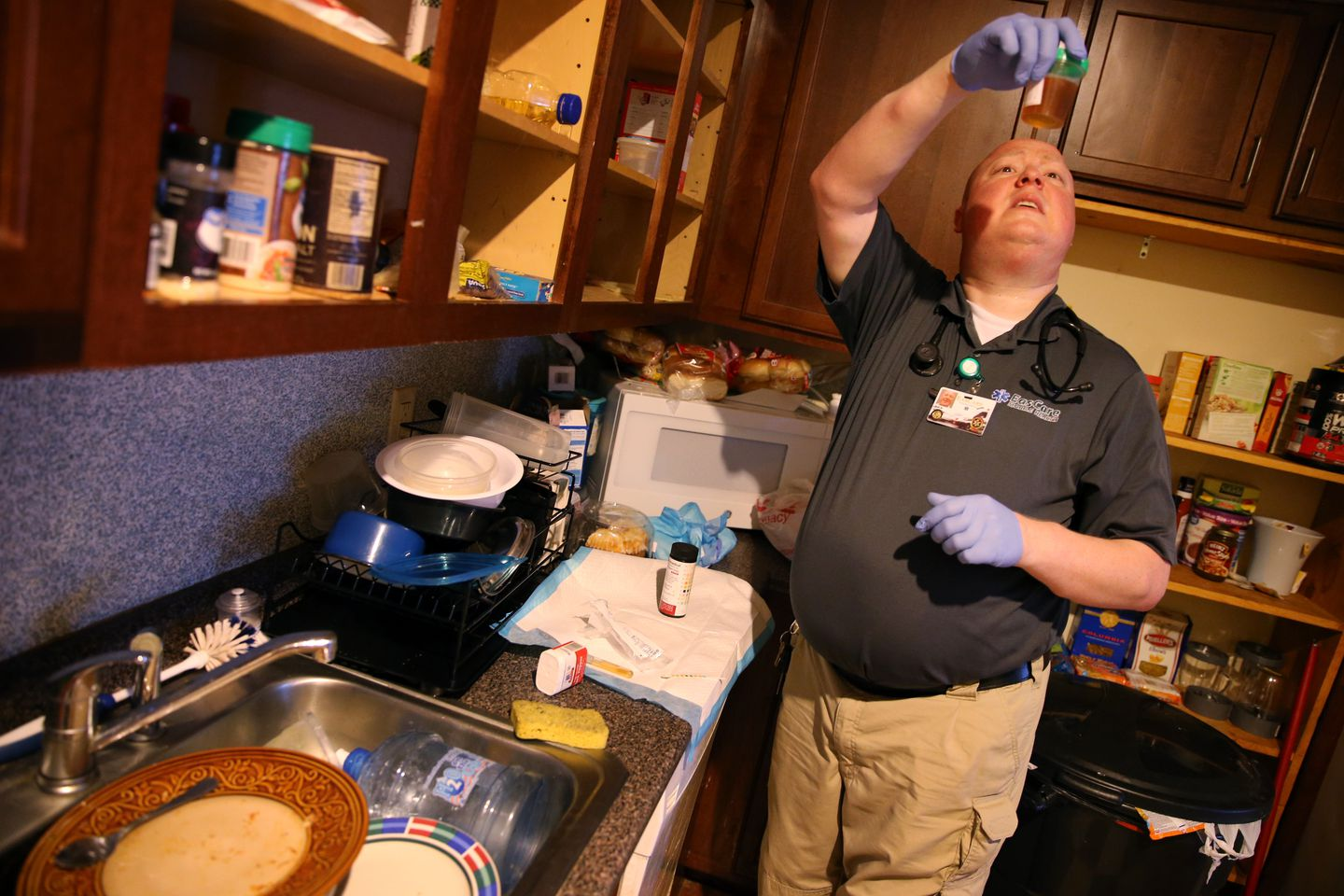 Paramedic Matthew Michaud examined a urine sample during a home visit.