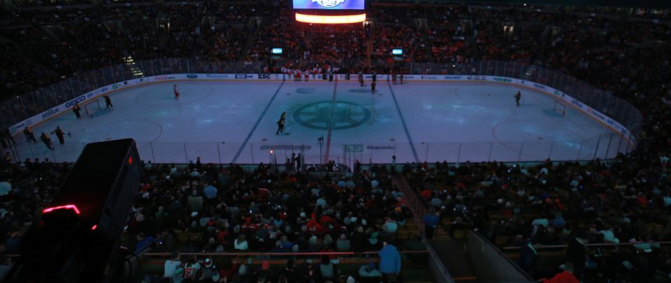 The TD Garden lights went out midway through the first period because of a power outage.