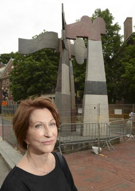 """Cynthia Hadzi, the wife of the late sculptor Dimitri Hadzi, in front of his sculpture """"Omphalos."""""""
