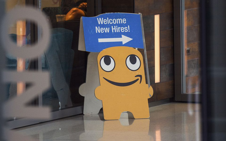 A sign directs new Amazon employees toward an orientation session on the retailer's campus in Seattle last month.
