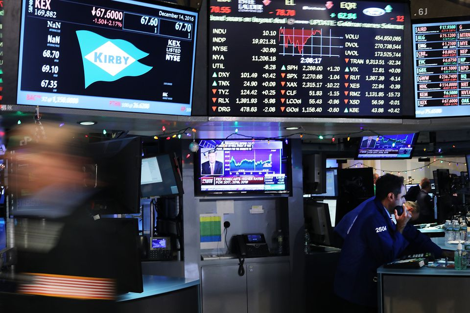 Traders worked on the floor of the New York Stock Exchange (NYSE) moments after Federal Reserve officials raised interest rates.