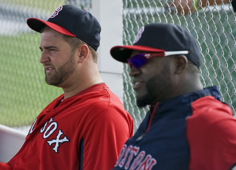 David Ortiz, right, with Mike Napoli, arrived at spring training on Tuesday.