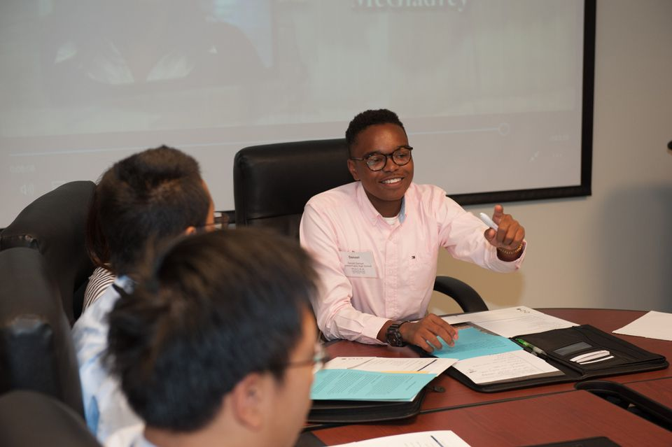 Denzel Samuel, a Boston resident who attends Wayland High School, asks a question at the Real World CPA panel hosted by the Massachusetts Society of Certified Public Accountants.