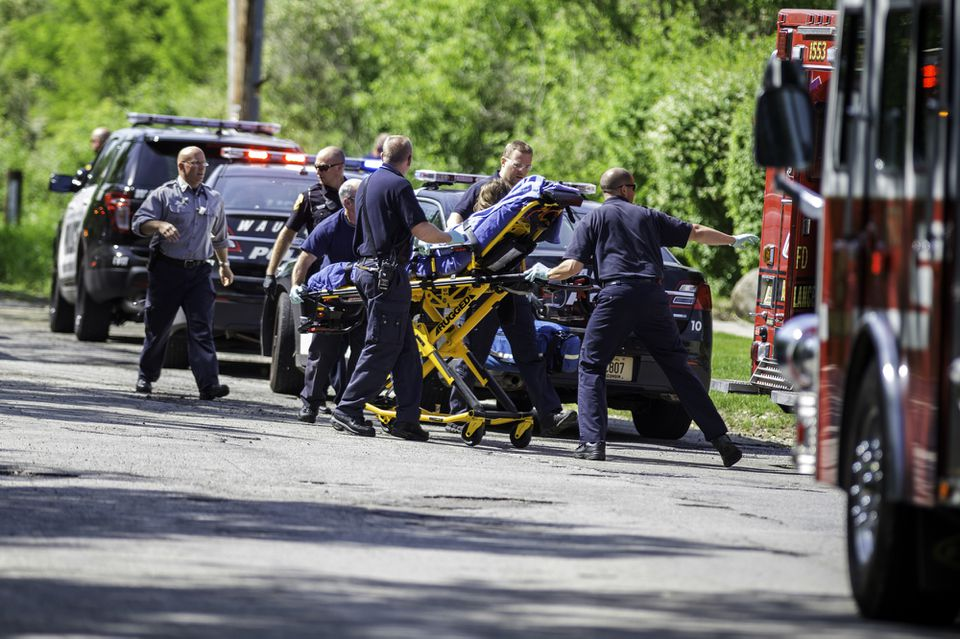 Rescue workers took a stabbing victim to an ambulance in Waukesha, Wis.