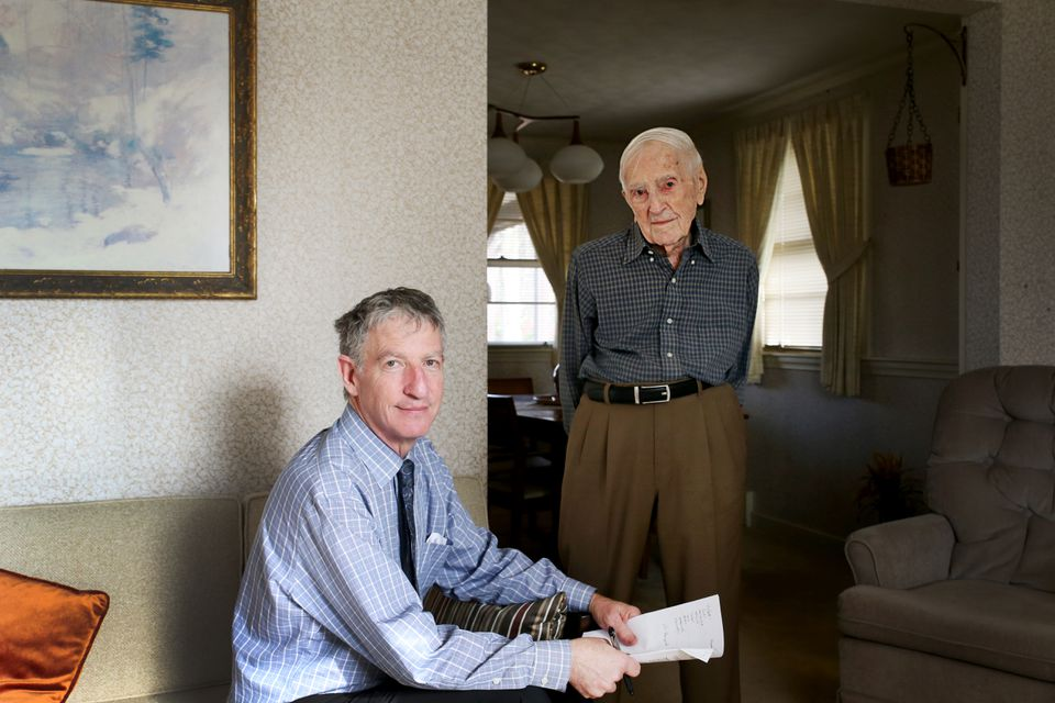 Dr. Thomas T. Perls, professor of medicine at Boston University, and Frederick Blizard, 105, pose for a portrait in Blizard's home in Norwood.