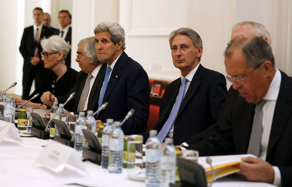 Secretary of State John Kerry, 3rd left, met with his counterparts from other countries at a hotel in Vienna, Austria.