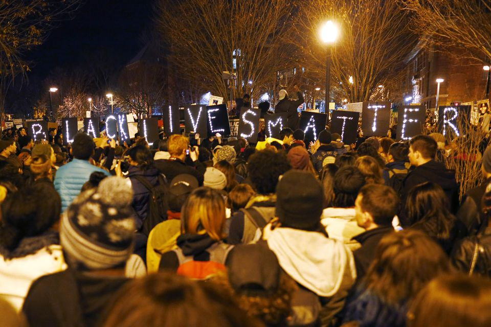 """Demonstrators held up lighted signs spelling out """"Black Lives Matter"""" during a protest in Boston on Nov. 25."""