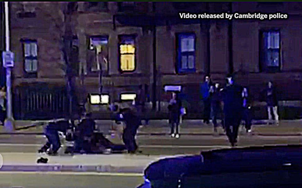"""Cambridge's mayor called a video of a police officer repeatedly striking a black Harvard University student while he was pinned to the ground by fellow officers """"disturbing"""" and promised that the findings of an internal probe would be made public."""