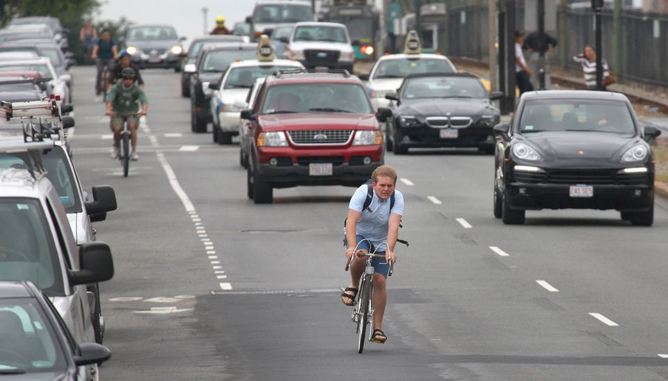 A bicyclist rode outside the lane reserved for riders on Tuesday on Commonwealth Avenue.
