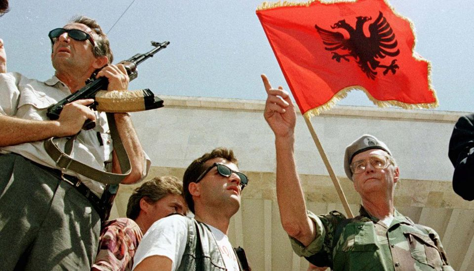 Leka Zogu led a crowd of armed protesters outside Albania's main elections building in 1997.