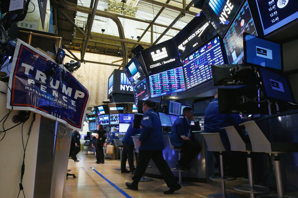 A campaign poster of Donald Trump is displayed on the floor of the New York Stock Exchange.